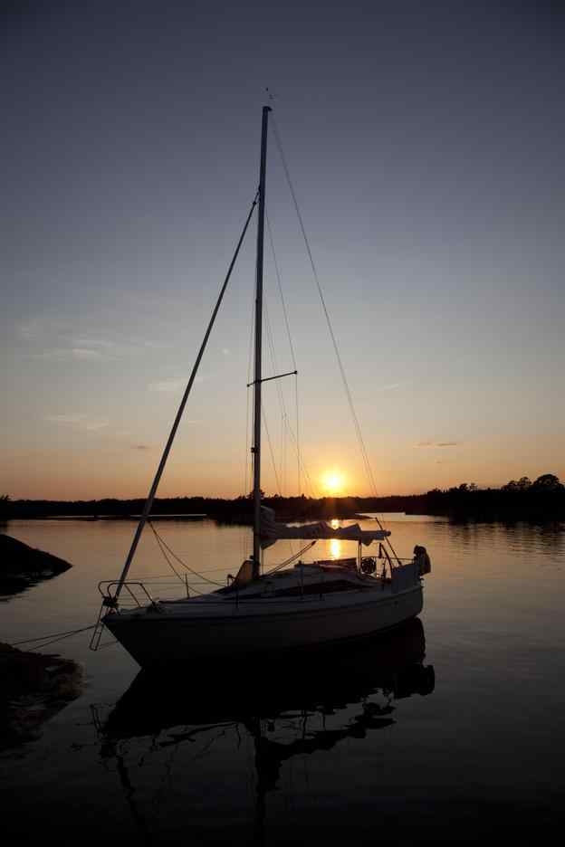 Sailboat silhouette with a beautiful Lake of the Ozarks sunset