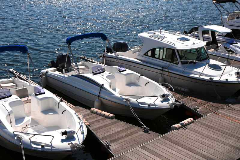 Pleasure boats docked at the pier of a Lake of the Ozarks marina